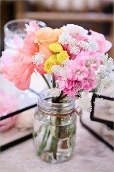 spring wedding florals in mason jars