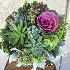 Bridal Bouquet of succulents, antique hydrangea, brassica, dusty miller and seeded eucalyptus. Floral by Le FLEUR