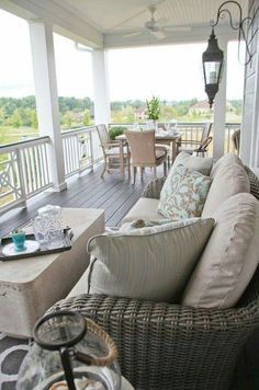 Airy porch with living and dining areas.