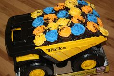 Dump Truck Cupcakes - Did these for a little boy turning two. Mom wanted plain cupcakes, but I found a big tonka truck to match the invitation to put them in, and she was thrilled!