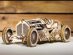 UGears Grand Prix Car Wooden Model (DIY Building Kit) Hand-Crank Powered Vehicle w/ Working Pistons, Wheels, Shocks Grand Prix, Kinetic Art, Automobile Industry, Wooden Puzzles, 3d Puzzles, Vintage Models, New Hobbies, Retro, Wood