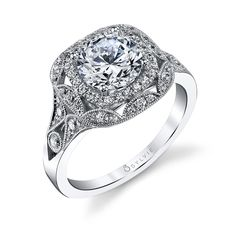 Style# S1211 Vintage Diamond Halo Engagement Ring - This vintage double halo diamond engagement ring features a 1.50 carat round brilliant center surrounded by a cushion halo of diamonds and both in another halo with milgrain and diamond accents which continue down the shank for a total of 0.48 carats. https://www.sylviecollection.com/vintage-diamond-halo-engagement-ring-s1211