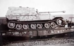 """A Tiger P """"Ferdinand"""" with it's crew, being transported by a military ordinance train"""