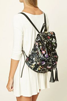 55c58b5be07f A faux leather backpack featuring an allover floral print