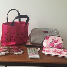 8-piece Victoria's Secret bag flower lip iPhone Victoria's Secret new with tags silver fashion show makeup bag, 3 brand new lipglosses (2 Candy Baby and 1 Minty Kiss), new with tags floral wristlet, new without tags small floral pouch, small red and pink Victoria's Secret tote and a snowglobe Victoria's Secret iPhone 6 case. Perfect to make a gift basket for the girl who LOVES VS! Or use the small tote and throw in some tissue...instant birthday, graduation gift! Victoria's Secret Other
