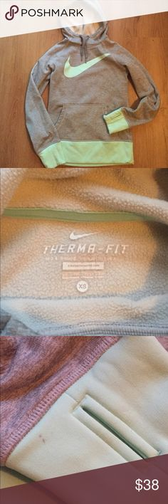 Nike thermafit hoodie Nike thermafit hoodie is super soft grey and mint material. Has thumb holes and beside one very tiny dark spot shown in pictures it is flawless. Worn but in great condition! Get so many compliments on this hoody but is too small now. Nike Tops Sweatshirts & Hoodies