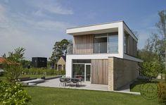 Cedertræ, tegl og STO-facade