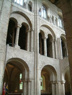 ROMANESQUE ARCHITECTURE, England - Norman transept, Winchester cathedral, 1079 (rebuilt in late middle ages). The surviving Norman aisled transpts at Winchester with great galleried tribunes and clestoreys shows the thick wall technique derived from Jumiéges and Caen in Normandy. The characteristic of Anglo-Norman, is a well-defined bay system expressed by the nave piers and vertical shafts.