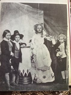 From the left, princess Alice, prince Alfred, the Princess Royale (Vicky) and princes Helena in les petite Savoyards, in 1854.