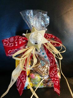 Western Cowboy Party Favor. New! Order your Themed Candy Bag Favors! We have over 150 different themes! Breakfast at Tiffany's, Vegas, Princess, Mickey Mouse, Minnie Mouse and many more. Nearly 2 pounds of wrapped favorites candies in a bag decorated exclusively for your event! Shipped only in the USA. www.tjscandybuffets.com