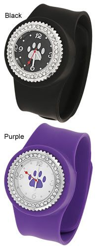 "Purple Paw Silicone Slap Watch  Item #47994. Ringed in rhinestones and constructed of solid silicone, the popular slap bracelet is updated to a sophisticated -- yet still fun! -- design that goes on and off with a quick slap. A bold paw behind the ticking hands reminds you of the cause with every check of the time.     Purple or Black  Silicone, silver-tone metal, & crystal  Removable face for ease of setting and changing battery  1.5"" W x 11"" L (3.8 z 27.9 cm)  Imported"