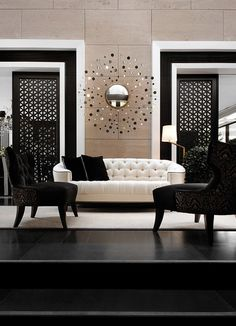 Black and white interior, sliding doors and a sunburst mirror. #interiordesign