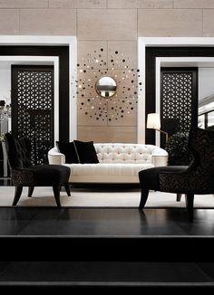 Black and white interior, sliding doors and a sunburst mirror. #interiordesign