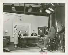 Radio Corporation of America (RCA) - Lenox R. Lohr (President of National Broadcasting Company), David Sarnoff (President of RCA) and Grover Whalen signing contracts while being filmed for television From New York Public Library Digital Collections.