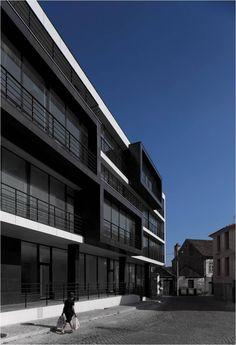 Collective Residential Building Commercial and residential space with 15 apartments. Site: Largo Joaquim Borges Artiaga Vila Nova de Tazem. Gouveia (Portugal) Architecture: Nuno Ladeiro.    photography: FG + SG