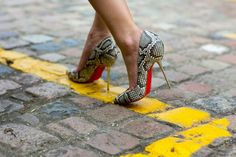 Snake print pumps and toe cleavage