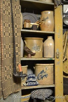 Prim Mustard Cupboard...and olde stoneware crocks & coverlet.
