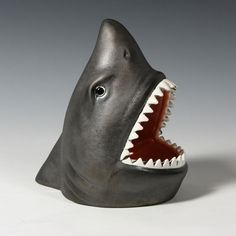Oh when the shark bites...fill the mouth with candy, treats, retainer and more.  A very fun container.