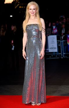 "8 October 2017 — Nicole Kidman in a strapless silver metallic 'Prada' gown w/ draped, sheer sleeves at the European premiere of ""Killing of a Sacred Deer"" during the BFI (British Film Institute) London Film Festival in London 