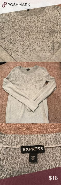 Express gray with silver sparkle sweater Excellent condition, and comfortable. This gray sweater from Express is perfect for the holidays. Has silver sparkles that cascade from neck line to just below bust Express Sweaters Crew & Scoop Necks
