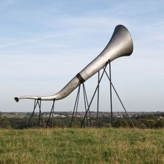 The sounds of the countryside are amplified when you place your ear towards one of these four enormous trumpets built by architects Studio Weave