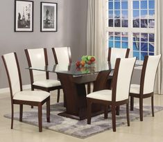 "Camelia  Dining Room  Suite in White  Table and 6 Side Chairs   $799.00     Measurements:  Bevel Edge Glass Table $360.00  42"" x  72"" x 30""H 1210T-4272-Base/Leg  12mm Bevel Glass 1210T-GL-4272     Side Chair $99.00  18"" x 20""x 41""H 1210S-WH      C/M 1210"