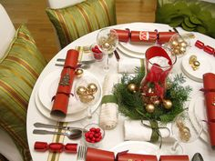 A great table setting during the holidays with those that use a round table! Very hard to find decent arrangements using this design. It has just the right amount of festive for the season.