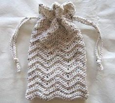 This Crochet Purse pattern is one of the free beginner crochet patterns on this website. It is mostly half double crochet (hdc) with a small amount of single crochet (sc) and uses the slip stitch (sl st) to close it and to create the drawstring. The crochet handbag, finished, measures 7 inches across and 11 inches tall, can be made larger