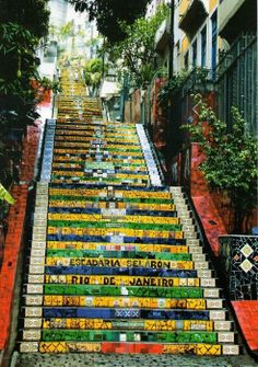 Selaron steps, Rio De Janeiro: the steps show a lot of colour. the bright yellow, burnt orange, apple green and ocean blue form a tetrad colour pattern.