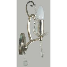 The Versailles 1Lt Wall Light is a delightful and decorative wall lamp for the home, hotel, or restaurant. This French inspired design has a stunning bracket and arm in antique silver that is finished with glass droplet accents. An exquisite design that would suit the more traditional decor.Globe Specification: 1 x 60w B15 Max.Dimensions:Height - 350mm.Width -120mm.Depth - 180mm.Dimmable - Yes.Power Rating: 240v.IP Rating: IP20.ASA: Australian Standards Approved.