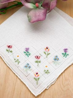 """Set of 3 Flower Bouquet Embroidered Handkerchiefs This is a set of 3 white handkerchiefs with colorful flower embroidery.    Each handkerchief has hand rolled edging and a lovely flower design embroidered in one corner. The flower design is made up of several flowers including daisies, roses and tulips. Each handkerchief is 100% cotton and measures approx. 12"""" x 12"""" square.    Perfect for the bride or her attendants. Also ideal for small gifts for any occasion."""