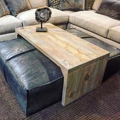 Leather ottoman/sliding wood coffee table. Super stylish and functional! www.thefindreno.com