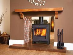 Decorative Ideas behind a Modern Wood Stove Double Sided Log Burner, Double Sided Fireplace, Log Burner Fireplace, Wood Burner, Brick Fireplaces, Modern Fireplaces, Living Room With Fireplace, New Living Room, Cottage Fireplace