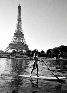 stand up paddle surfing next to the eiffel tower, how cool! #SUP stand up paddle boarding