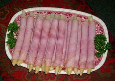 Immer noch eine feine Bereicherung zum Frühstück oder abends: Spargelröllchen. In die mit Spargel gefüllten Schinkenscheiben   füllt man gerne auch noch Fleischsalat ein. Foto: presseweller