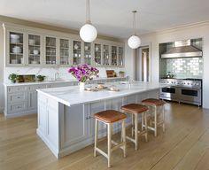 Great kitchen. Love the layout, cabinetry, island, and backsplash. Stainless. (Backless barstools are a no-go though.)
