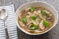 Chicken & Udon Noodle Soup with Napa Cabbage & Dried Lime. Visit https://www.blueapron.com/ to receive the ingredients.