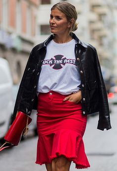 Norwegian model, blogger and TV presenter Janka Polliani looks hella business in her ballsy slogan tee and bright red ruffle skirt at Stockholm Fashion Week. Bringing extra new-season pizzaz is her shiny black leather jacket and coordinating bag on gold chain