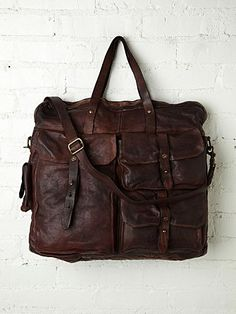 """$999.95 (seriously!) ...made in Italy... *16 1/2"""" depth, 17"""" width across front, 3"""" thickness at bottom  *6 1/2"""" handle drop, 39"""" long strap length (can be made longer or shorter)  Campomaggi Ressini Travel Bag at Free People Clothing Boutique"""