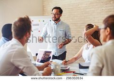 Modern businessman explaining his ideas to colleagues at seminar - stock photo