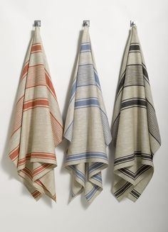 See...it is not just me who loves them! Linen-towels-stripes-neutral-red-blue-black. www.remodelista.