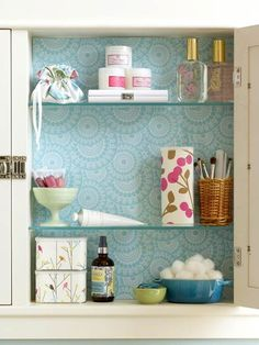 Pretty Inside and Out: Make storage a bit prettier by lining the back of a medicine cabinet with decorative paper. organization-storage workout-motivation ab-challenge
