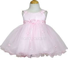 Baby Matte Satin Bodice Pink Dress with Tulle Skirt: This classic baby ballerina dress is the epitome of sweetness and charm. It is perfect for any event as it is formal and very adorable. Featuring an extra large skirt supported by crinoline and multiple layers of tulle, your little baby can not only look as perfect as the little ballerina in a jewelry box, but she can spin and dance like one too.