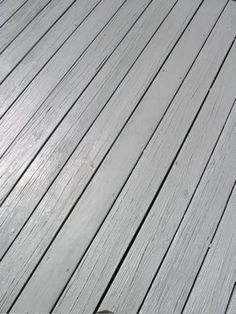 The deck needs a coat of weatherproofing:  My house is black and white.  I'm thinking that a grey stain would look fantastic.