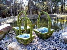 More beautiful wire and moss baskets now with a surprise earthy root woven into it!