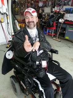 Gordy with his new PXi50.2 Amplified Controller on his #wheelchair! Look at the happiness a little #KICKER can bring.