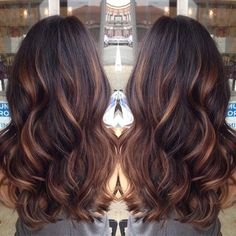 dark brown hair with golden caramel balayage'd high lights . soo wanna dye my hair this color