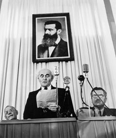 ISRAEL. Tel-Aviv. May 14th, 1948. Founder of the state of Israel, David Ben-Gurion reads the proclamation that will establish Israel as an independent nation.  Robert Capa © International Center of Photography/Magnum Photos
