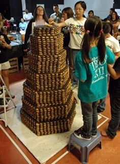 The tallest cookie tower measured 1.83 m (6 ft 1/8 in) tall and was constructed by the Girl Scouts of Nassau County (USA) at the Roosevelt Field Mall in Garden City, New York, USA, on 9 January 2010. Now you know!