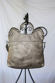 Alyssa Elite Handbag in Pewter $70.00  Go to jtnmissions.org to order yours today!  100% of the proceeds go to missions local and worldwide.